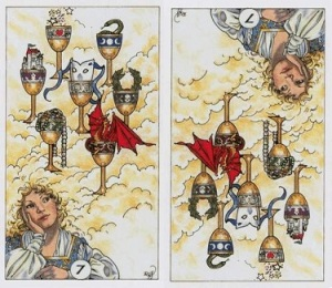 "7 of Cups (upright and inverted) as depicted in the Robin Wood Tarot. This is the traditional ""castles in the air"" card (note the head in the clouds), with its inverted form being more akin to ""wake up & smell the coffee""."